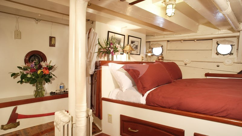 Stateroom 3: Queen Bed shown (+ 2 Single Beds)
