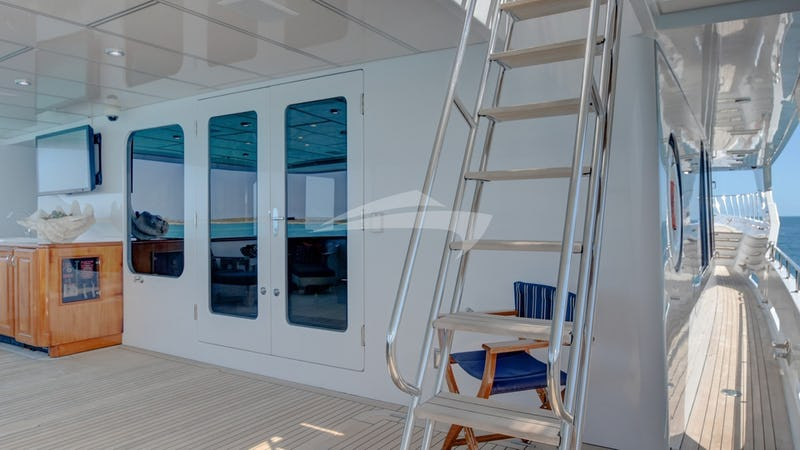 REFLECTIONS :: Stairs to aft deck and flybridge