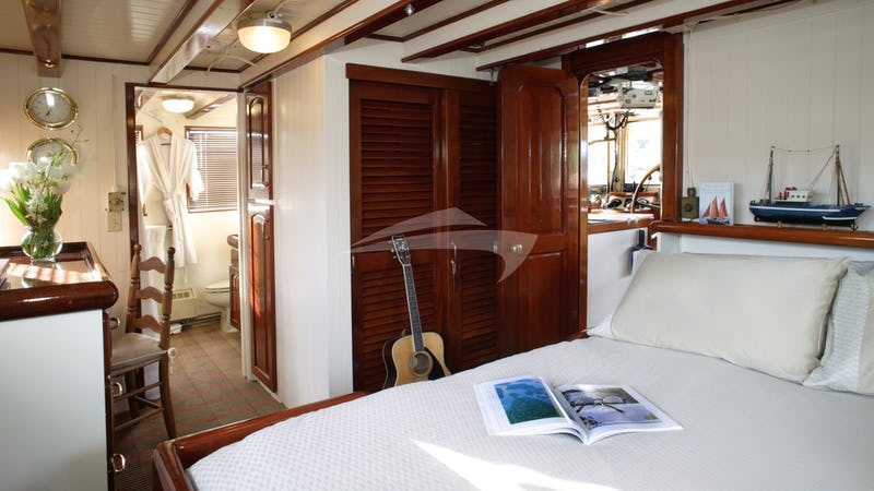 VIP Stateroom with Queen Bed on Upper Deck.