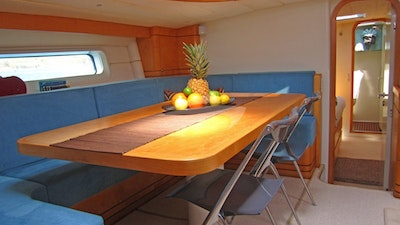 Dining showing new blue cushions