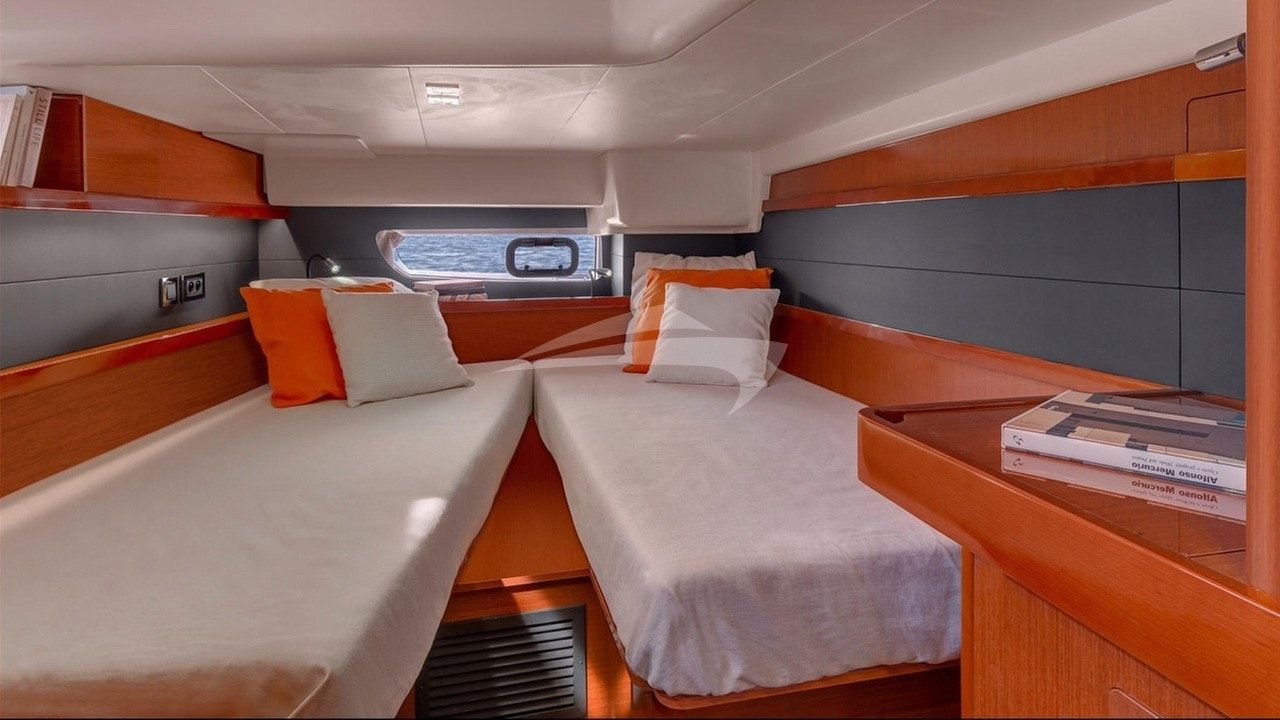 Aft guest suite set up as a twin berth cabin