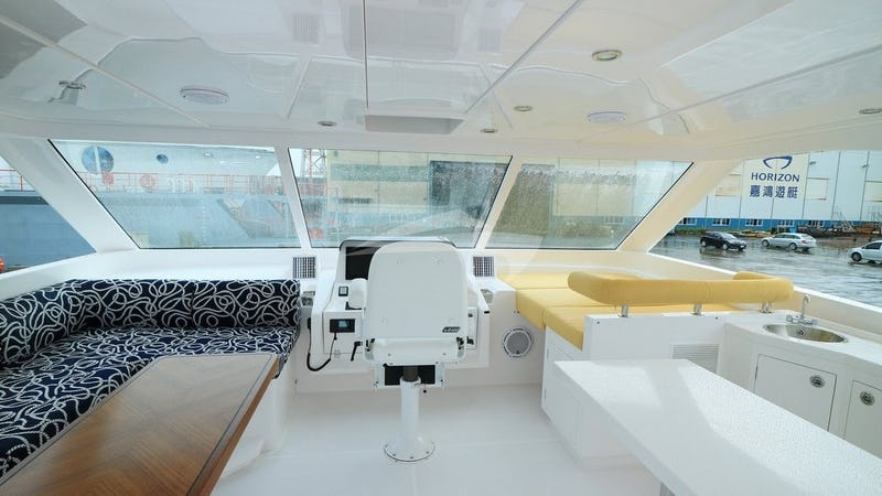 ETERNITY :: Flybridge helm and lounging area