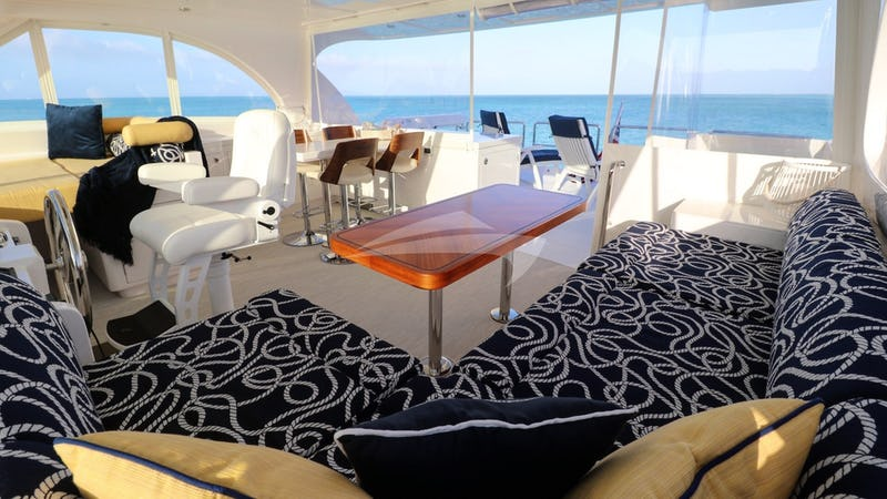 ETERNITY :: Flybridge helm, dining and lounging area